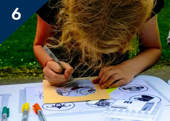 Girl creating a stained glass window drawing for an exhibition