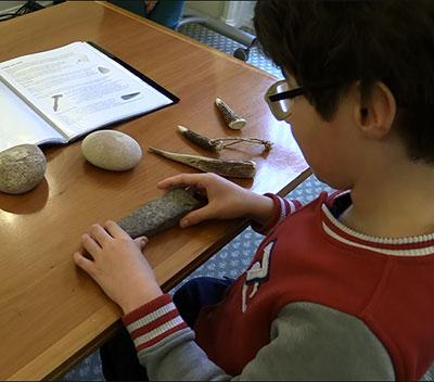 A boy examining some Malvern stones