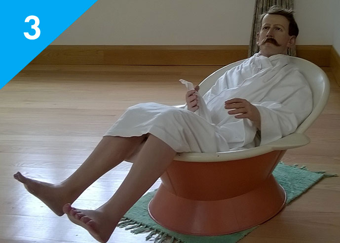 A model of an Edwardian man sitting in a bath tub as part of the water cure